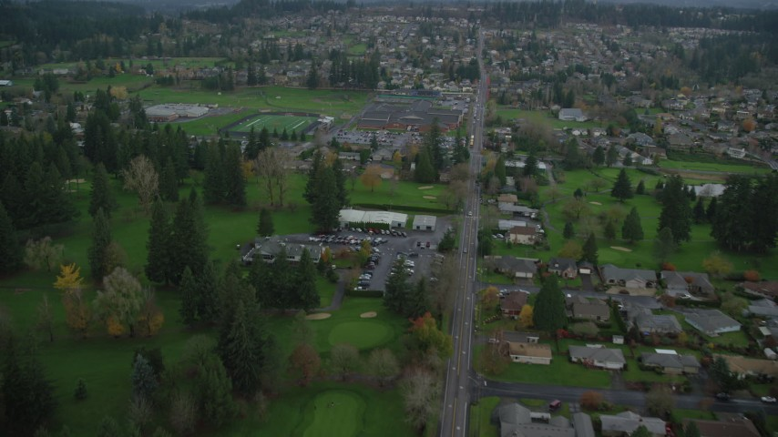 6K stock footage aerial video approaching and flying over Washougal High School and sports fields in Washougal, Washington Aerial Stock Footage | AX153_173