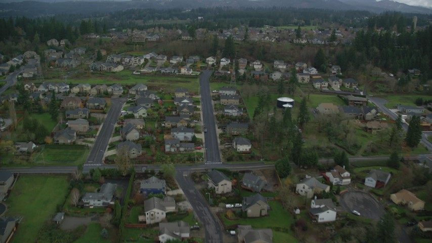 6K stock footage aerial video flying over suburban tract homes in Washougal, Washington Aerial Stock Footage | AX153_175