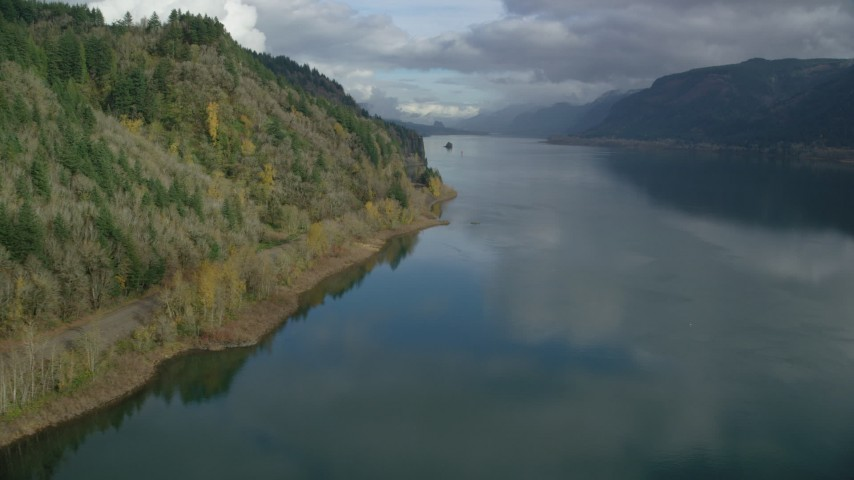6K stock footage aerial video flying low over the river in Columbia River Gorge, Oregon Aerial Stock Footage | AX154_002