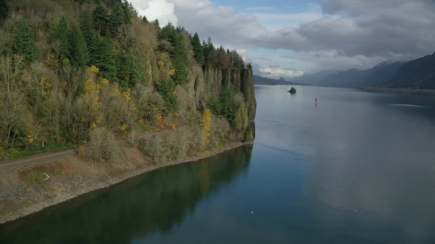 6K stock footage aerial video approaching train tracks and tunnel in the Columbia River Gorge, Oregon Aerial Stock Footage | AX154_005