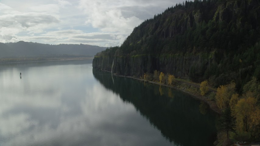 6K stock footage aerial video approaching a railroad tunnel and Cape Horn Falls in Columbia River Gorge, Washington Aerial Stock Footage | AX154_009