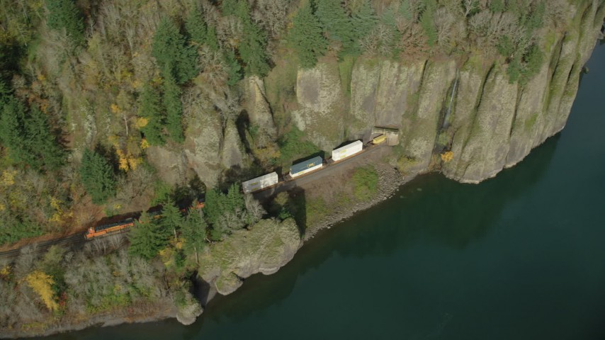 6K stock footage aerial video of a cargo train leaving Cape Horn Railroad Tunnel in the Columbia River Gorge, Washington Aerial Stock Footage | AX154_014