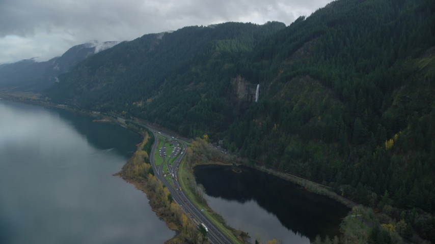 6K stock footage aerial video approaching Multnomah Falls on a Columbia River Gorge cliff face in Multnomah County, Oregon Aerial Stock Footage | AX154_019