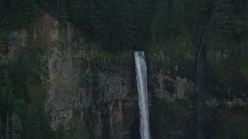 6K stock footage aerial video flying away from Multnomah Falls on the Oregon side of Columbia River Gorge Aerial Stock Footage | AX154_021