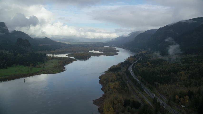 6K stock footage aerial video following the river and I-84 toward islands in the Columbia River Gorge Aerial Stock Footage | AX154_024