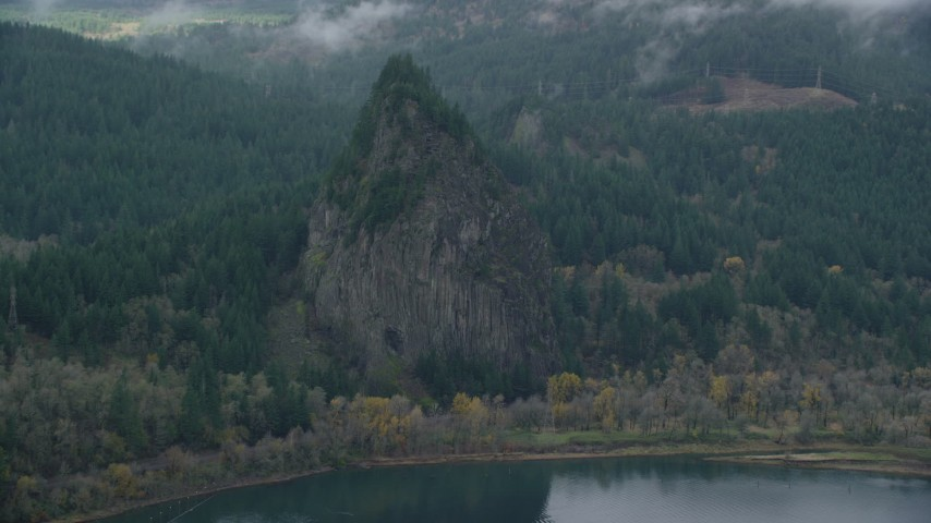 6K stock footage aerial video flying by Beacon Rock in the Columbia River Gorge, Skamania County, Washington Aerial Stock Footage | AX154_027