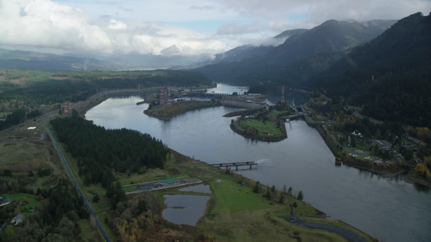 6K stock footage aerial video approaching Bonneville Dam in the Columbia River Gorge Aerial Stock Footage | AX154_028