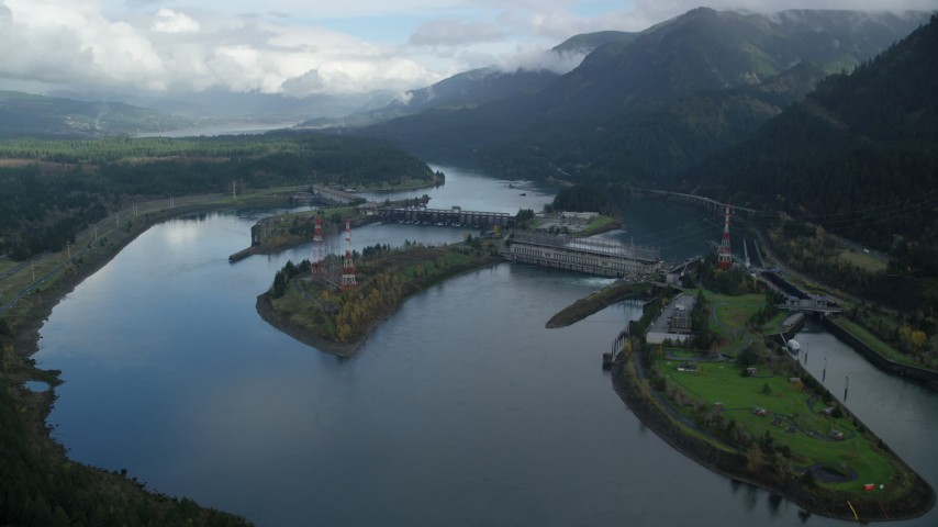 6K stock footage aerial video flying by the Bonneville Dam in Columbia River Gorge Aerial Stock Footage | AX154_029