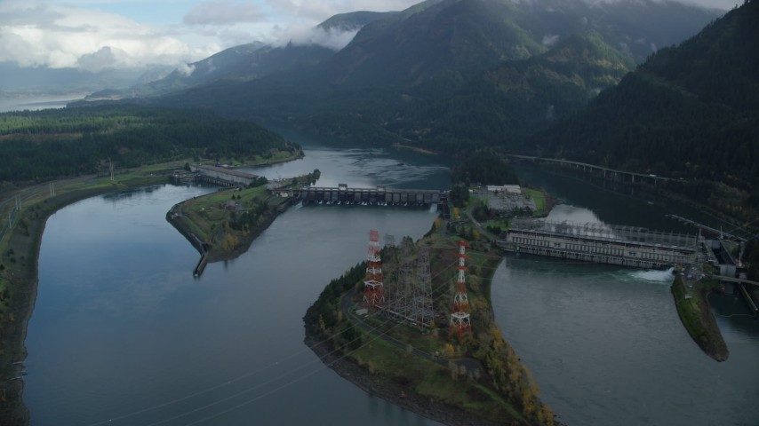 6K stock footage aerial video orbiting Bonneville Dam in the Columbia River Gorge Aerial Stock Footage | AX154_030