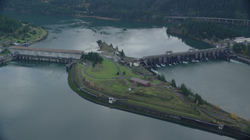6K stock footage aerial video orbiting of Bonneville Dam in Columbia River Gorge Aerial Stock Footage | AX154_031