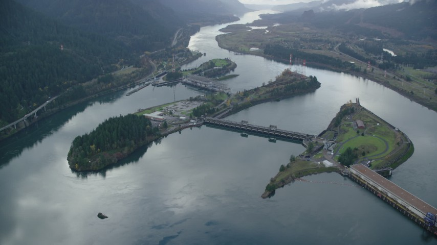 6K stock footage aerial video orbiting the Bonneville Dam in the Columbia River Gorge Aerial Stock Footage | AX154_034