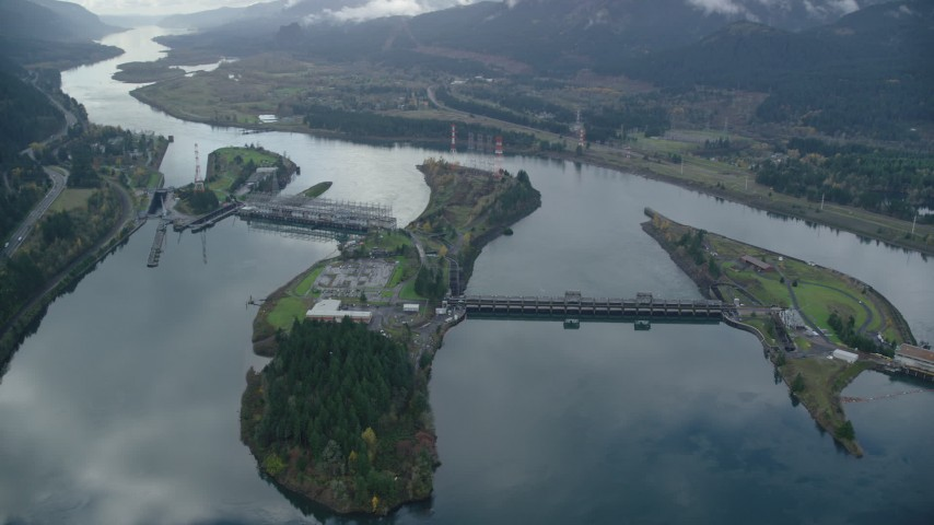 6K stock footage aerial video orbiting Bonneville Dam in the Columbia River Gorge Aerial Stock Footage | AX154_035