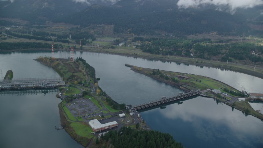 6K stock footage aerial video orbiting of the Bonneville Dam in Columbia River Gorge Aerial Stock Footage | AX154_036
