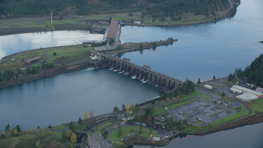 6K stock footage aerial video orbiting Bonneville Dam structures in the Columbia River Gorge Aerial Stock Footage | AX154_038