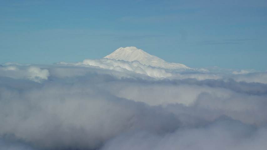 6K stock footage aerial video of Mt Adams' snowy summit in the distance and low cloud cover, Mount Adams, Cascade Range, Oregon Aerial Stock Footage AX154_069 | Axiom Images