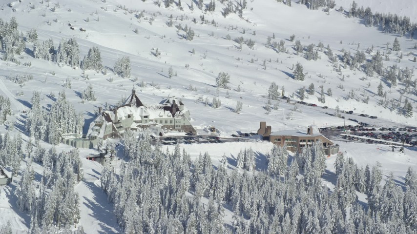 6K aerial video orbiting Timberline Lodge, located on Mount Hood, Cascade Range, Oregon Aerial Stock Footage | AX154_089