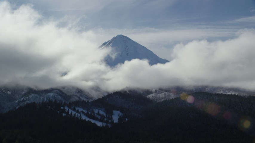 6K stock footage aerial video of clouds around the snowy summit of Mount Hood, Cascade Range, Oregon Aerial Stock Footage | AX154_131