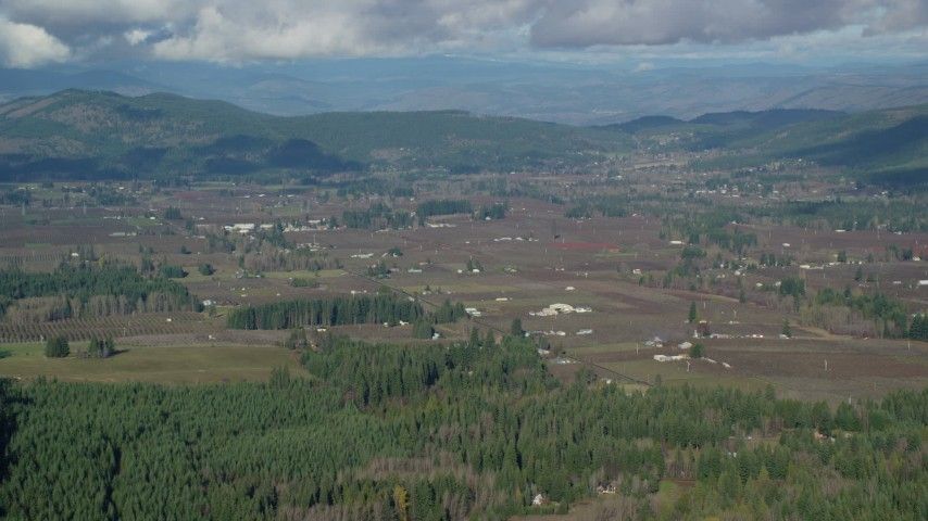6K stock footage aerial video approaching farms and farmland in Parkdale, Oregon Aerial Stock Footage | AX154_136