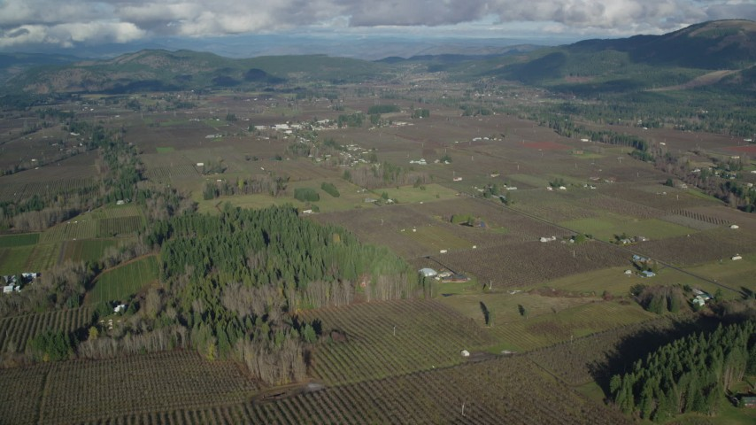 6K aerial video approaching farms and fields in Parkdale, Oregon Aerial Stock Footage | AX154_138