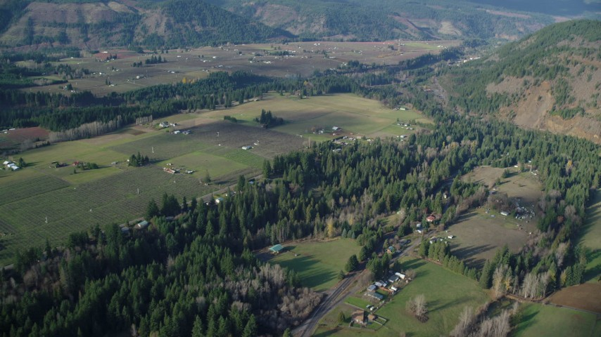 6K stock footage aerial video flying by rural farms and fields in Parkdale, Oregon Aerial Stock Footage | AX154_143
