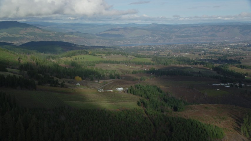 6K stock footage aerial video of a view across farms in Hood River, Oregon Aerial Stock Footage   AX154_149