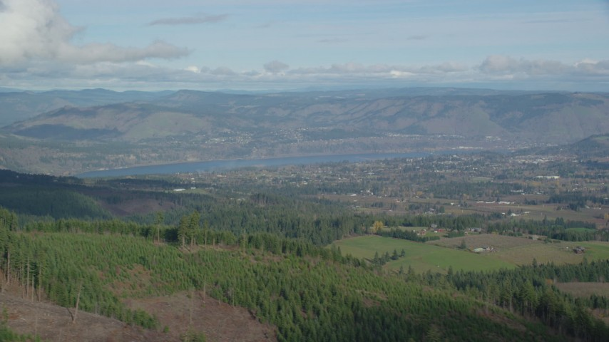 6K stock footage aerial video of Columbia River and Farms in Hood River, Oregon Aerial Stock Footage | AX154_150