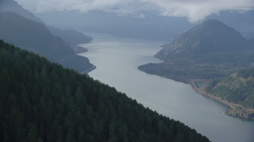 6K stock footage aerial video approaching the Columbia River in Columbia River Gorge Aerial Stock Footage | AX154_155