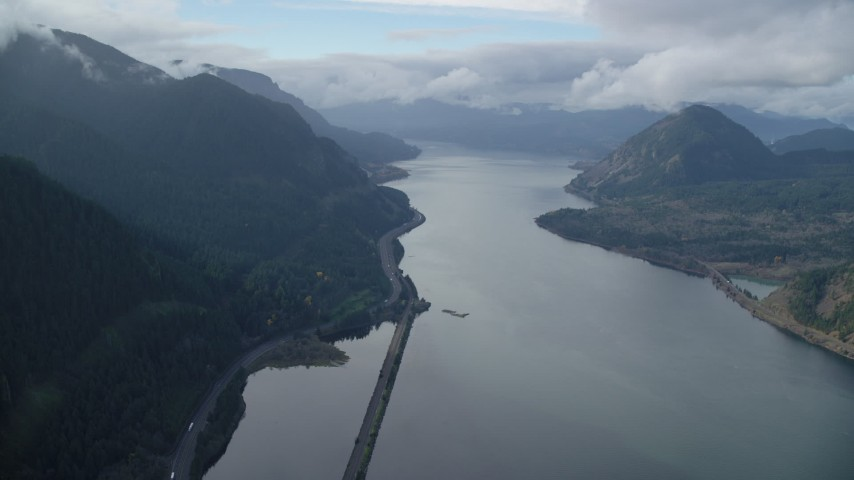 6K stock footage aerial video flying over the Columbia River toward I-84 highway in Columbia River Gorge Aerial Stock Footage | AX154_157
