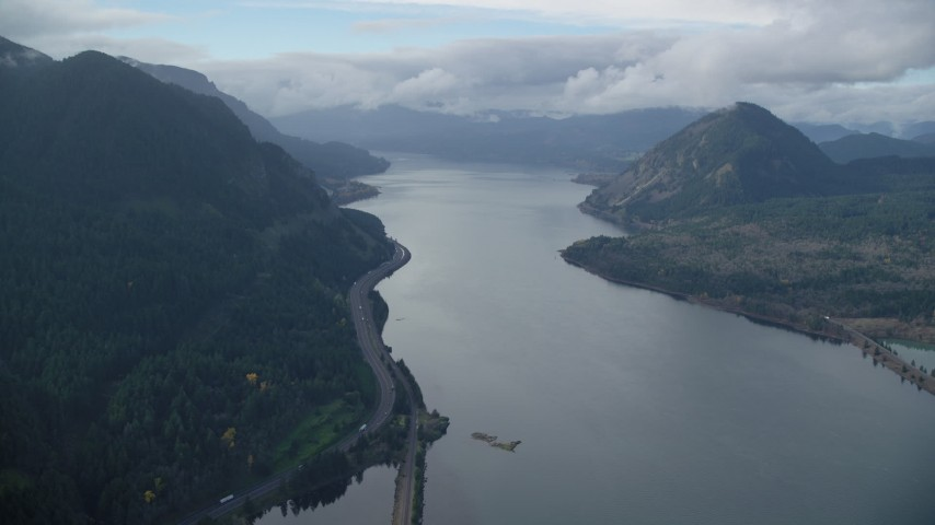 6K stock footage aerial video flying over the Columbia River to approach I-84 in the Columbia River Gorge Aerial Stock Footage | AX154_158
