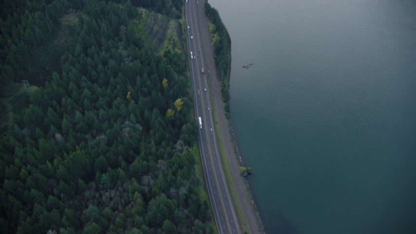 6K stock footage aerial video of a bird's eye view of light traffic on Interstate 84 in Columbia River Gorge, Hood River County, Oregon Aerial Stock Footage | AX154_159