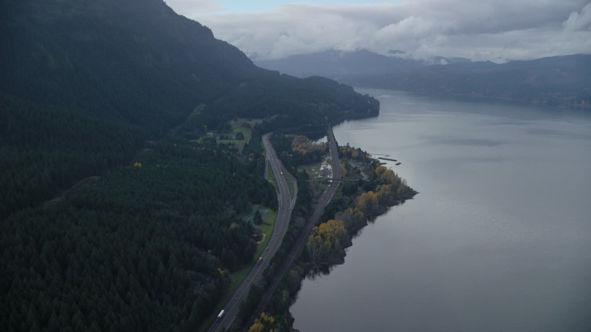 6K aerial video flying over light traffic on Interstate 84 in Columbia River Gorge Aerial Stock Footage | AX154_161