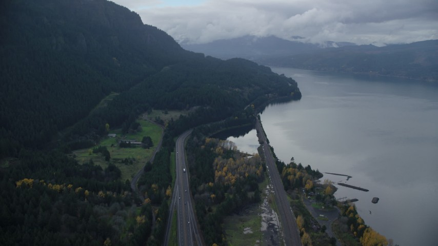 6K aerial video following Interstate 84 with light traffic through the Columbia River Gorge Aerial Stock Footage | AX154_162