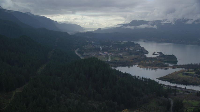 6K aerial video approaching I-84 and the small town of Cascade Locks, Oregon in Columbia River Gorge Aerial Stock Footage | AX154_165