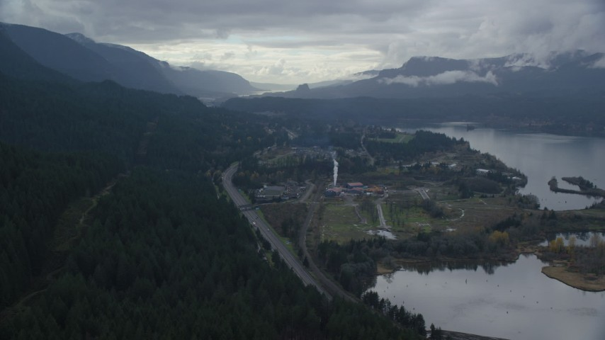 6K aerial video flying over I-84 and forest by the small town of Cascade Locks, Oregon in Columbia River Gorge Aerial Stock Footage | AX154_166