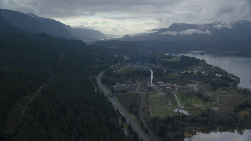 6K stock footage aerial video flying over I-84 and forest by the small town of Cascade Locks, Oregon in Columbia River Gorge Aerial Stock Footage | AX154_166