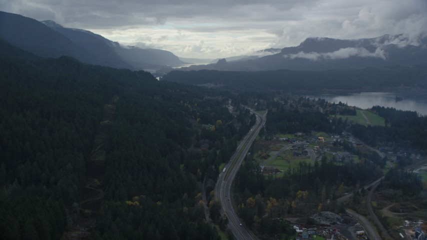 6K stock footage aerial video flying over I-84 and forest beside Cascade Locks, Oregon in Columbia River Gorge Aerial Stock Footage | AX154_167