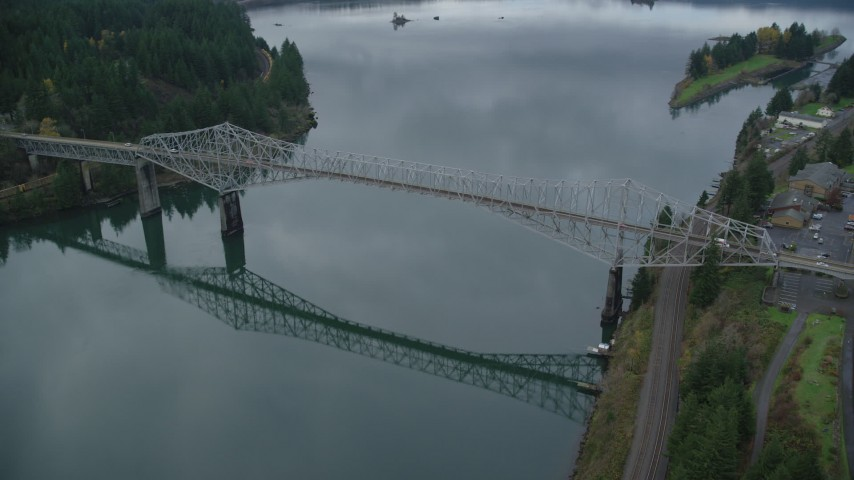 6K stock footage aerial video of a reverse view of the Bridge of the Gods in Cascade Locks, Columbia River Gorge, Oregon Aerial Stock Footage | AX154_174