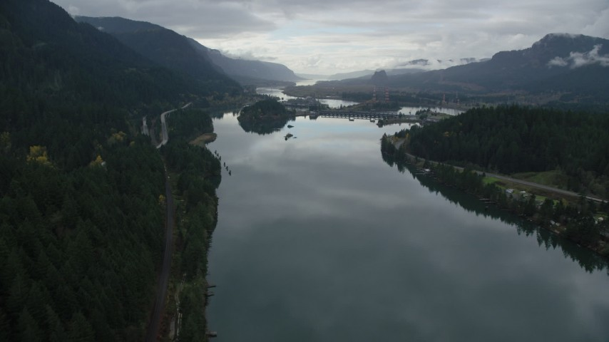 6K stock footage aerial video approaching the Bonneville Dam in the Columbia River Gorge Aerial Stock Footage | AX154_175