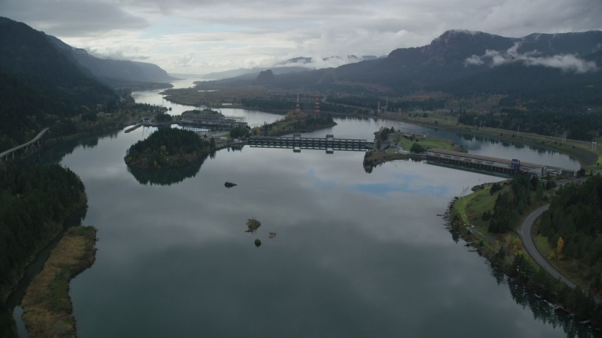 6K stock footage aerial video approaching the Bonneville Dam in the Columbia River Gorge Aerial Stock Footage | AX154_176