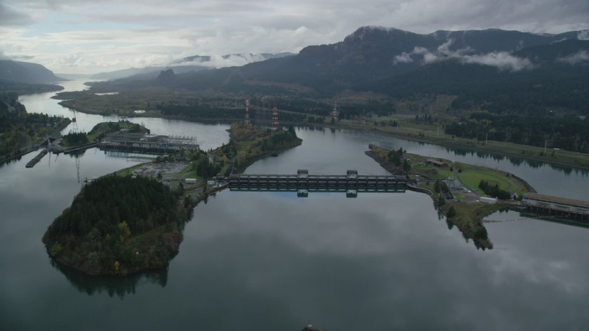 6K stock footage aerial video flying by one of the Bonneville Dam structures in the Columbia River Gorge Aerial Stock Footage | AX154_177