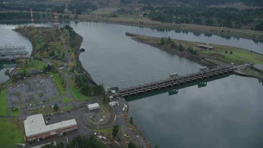 6K stock footage aerial video tracking on the Bonneville Dam in the Columbia River Gorge Aerial Stock Footage | AX154_178