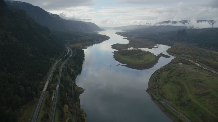 6K stock footage aerial video following Columbia River and the I-84 highway to approach islands in Columbia River Gorge Aerial Stock Footage | AX154_180