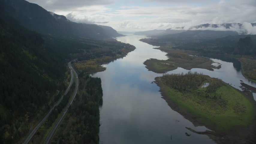 6K stock footage aerial video of Interstate 84, Columbia River and islands in Columbia River Gorge Aerial Stock Footage | AX154_181