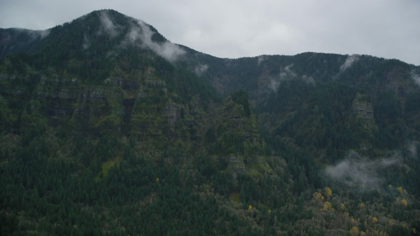 6K stock footage aerial video of a rugged mountain cliffs and misty clouds on the Oregon side of Columbia River Gorge Aerial Stock Footage | AX154_185