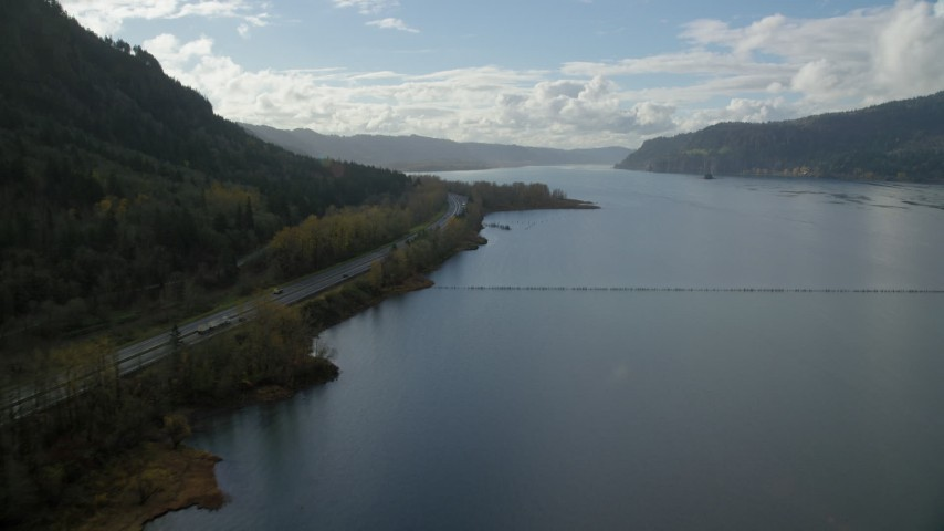 6K stock footage aerial video flying by Interstate 84 highway with light traffic on the Oregon side of Columbia River Gorge Aerial Stock Footage | AX154_190