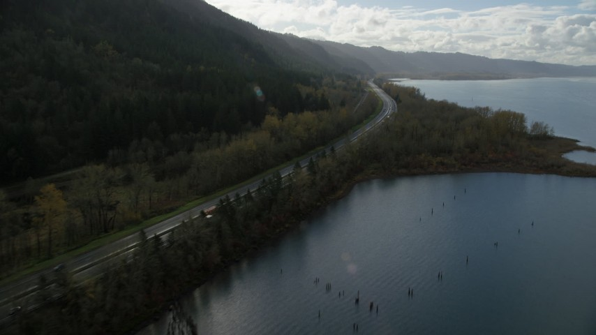 6K stock footage aerial video flying by the I-84 highway with light traffic on the Oregon side of Columbia River Gorge Aerial Stock Footage | AX154_191