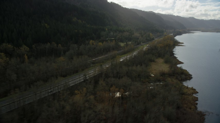 6K stock footage aerial video of I-84 highway with light traffic on the Oregon side of Columbia River Gorge Aerial Stock Footage | AX154_192