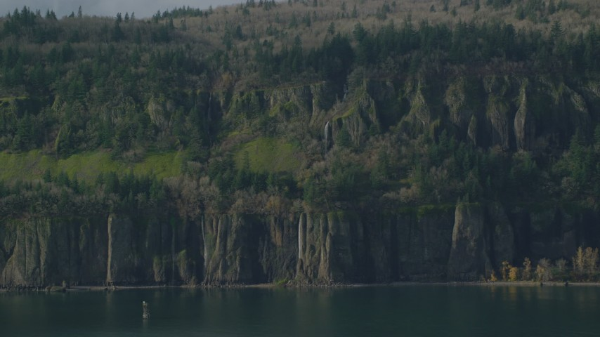 6K stock footage aerial video of waterfalls and steep green cliffs on the Washington side of Columbia River Gorge Aerial Stock Footage | AX154_193