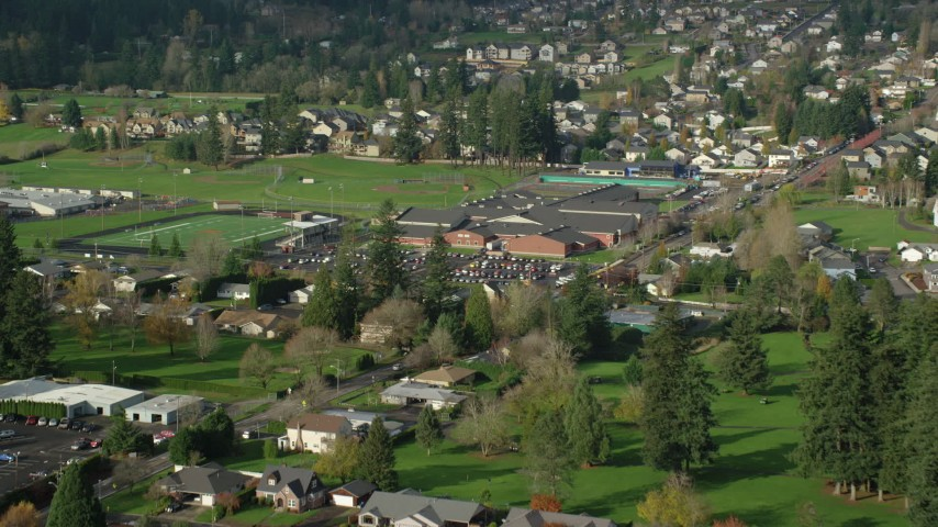 6K stock footage aerial video approaching and flying over Washougal High School in Washougal, Washington Aerial Stock Footage | AX154_202