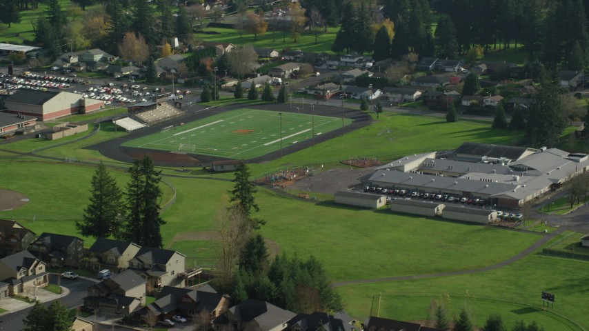 6K stock footage aerial video orbiting Gause Elementary and the Washougal High School football field in Washougal, Washington Aerial Stock Footage | AX154_204